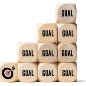 many cubes with the word goal and a target symbol on white background