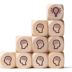 many people together having an idea symbolized by icons on cubes on white background